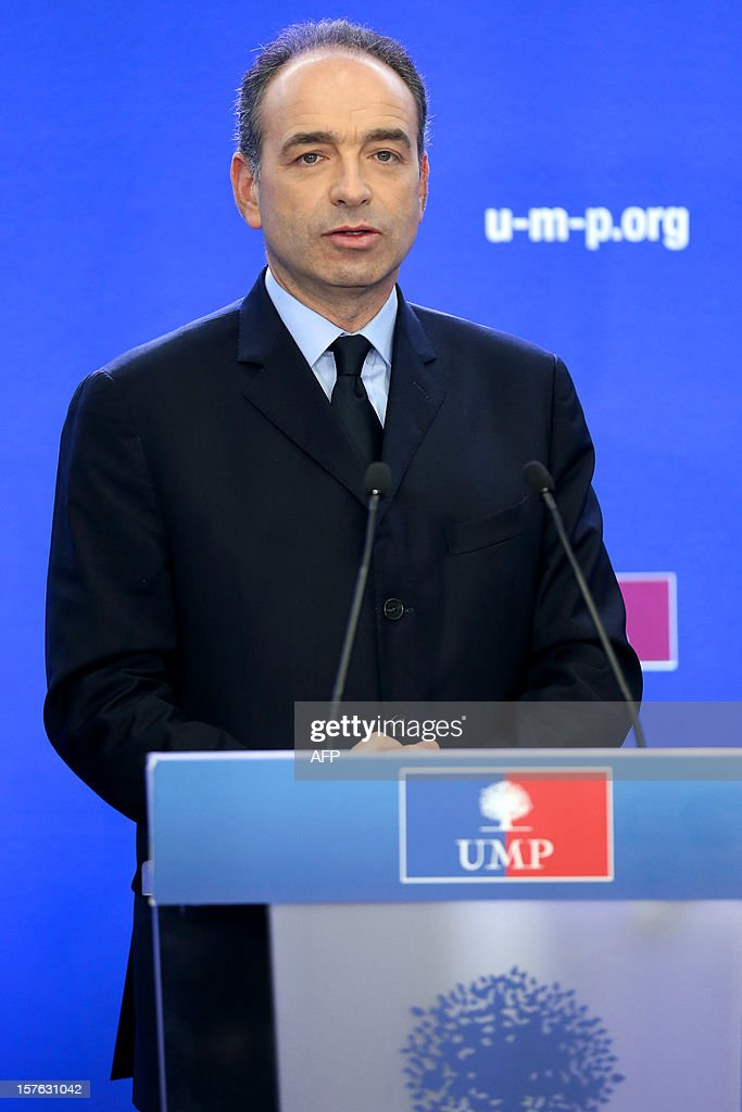 French President of the Union for a Popular Movement right-wing opposition party (UMP) Jean-Francois Cope holds a press conference on December 5, 2012 at the party headquarters in Paris. Cope denounced the 'guilty silence' of the governement towards his ecologist ally concerning the Flamanville nuclear plant, northwestern France. French energy group EDF raised recently the total cost of its long-delayed new-generation nuclear reactor at Flamanville by 2 billion euro (2.6 billion US dollar) to 8.5 billion (10.3 billion US dollar). Built by French energy giant Areva and due to be operated by EDF, it is one of four European Pressurised Reactor projects in the world, including another much-delayed one planned in Finland. AFP PHOTO / THOMAS SAMSON