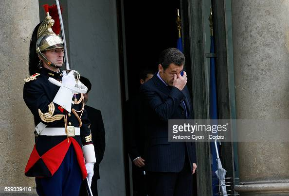 French President Sarkozy waits at the entrance of the Elysee Palace to hold meetings with Qatari Emir Sheikh Hamad Ben Khalifa Al Thani Lebanese...