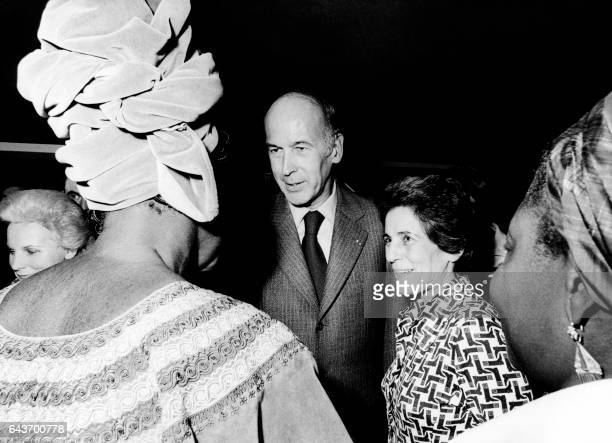 French President Valery Giscard d'Estaing and French Secretary of State Francoise Giroud speaks with a woman during the inauguration of the...