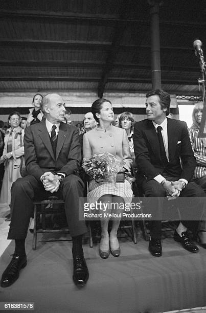 French president Valery Giscard d'Estaing and his wife AnneAymone speak with actor Alain Delon during a campaign rally at the Porte de Pantin...