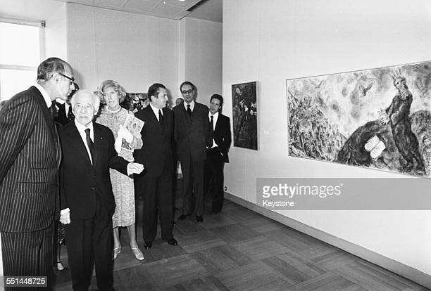 French President Valery Giscard d'Estaing and Minister of Culture Michel d'Ornano attending an art exhibition of work by Marc Chagall at the Louvre...