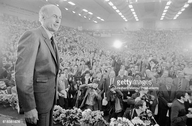 French president Valery Giscard d'Estaing stands before a massive crowd of supporters while campaigning for reelection in the 1981 presidential...