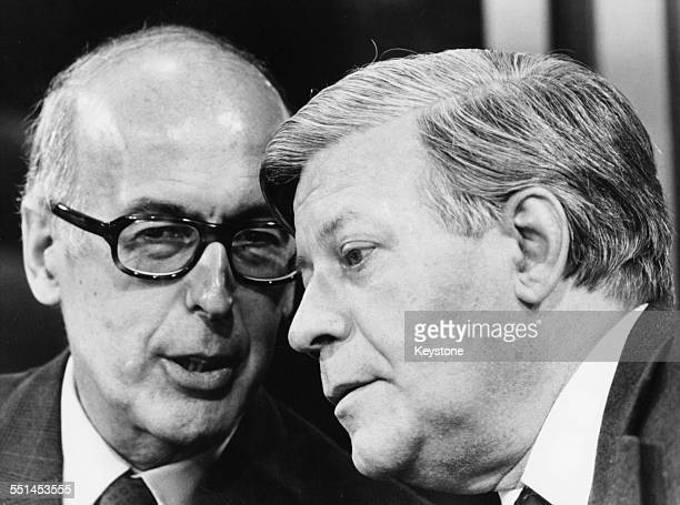French President Valery Giscard d'Estaing talking to German Chancellor Helmut Schmidt at a press conference in Bonn July 15th 1980