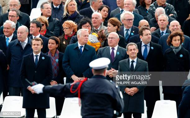 French presidentelect Emmanuel Macron and former president Nicolas Sarkozy stand guard next to French Minister for Town and Country Planning Rural...