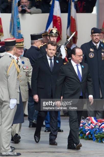 French presidentelect Emmanuel Macron and outgoing French President Francois Hollande attend a ceremony to mark the Western allies' World War Two...