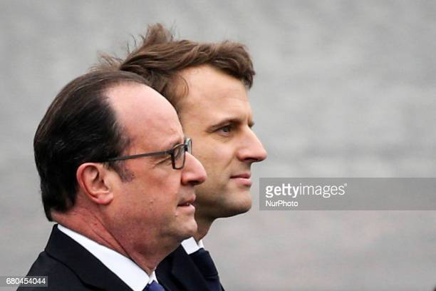 French presidentelect Emmanuel Macron and outgoing French President Francois Hollande during a ceremony marking the 72nd anniversary of the victory...