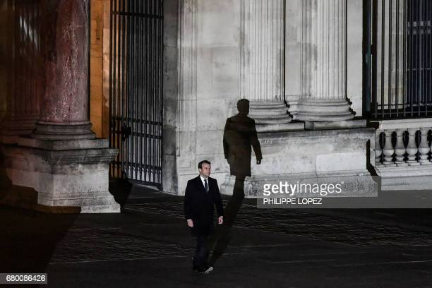 TOPSHOT French presidentelect Emmanuel Macron arrives to deliver a speech at the Pyramid at the Louvre Museum in Paris on May 7 after the second...