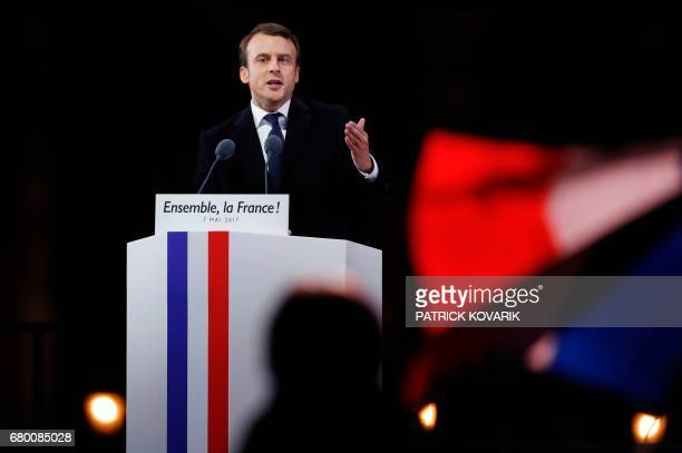 French presidentelect Emmanuel Macron delivers a speech in front of the Pyramid at the Louvre Museum in Paris on May 7 after the second round of the...