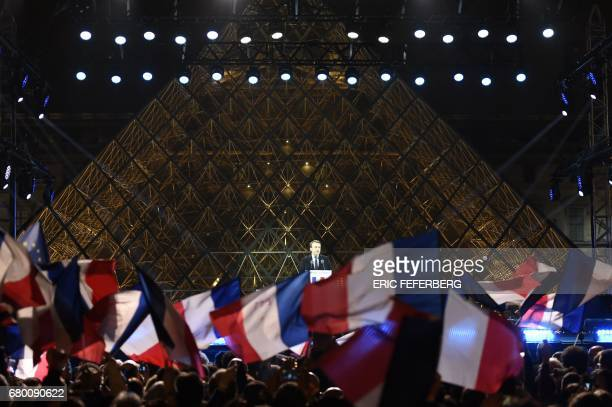 TOPSHOT French presidentelect Emmanuel Macron delivers a speech in front of the Pyramid at the Louvre Museum in Paris on May 7 after the second round...