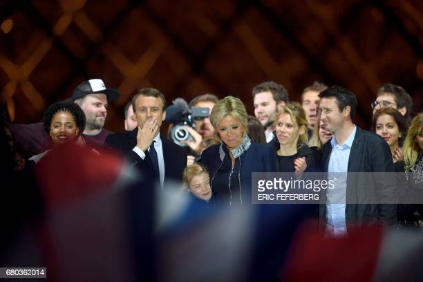 French presidentelect Emmanuel Macron his wife Brigitte Trogneux his stepdaughter Tiphaine Auziere with her husband Antoine Choteau and his...