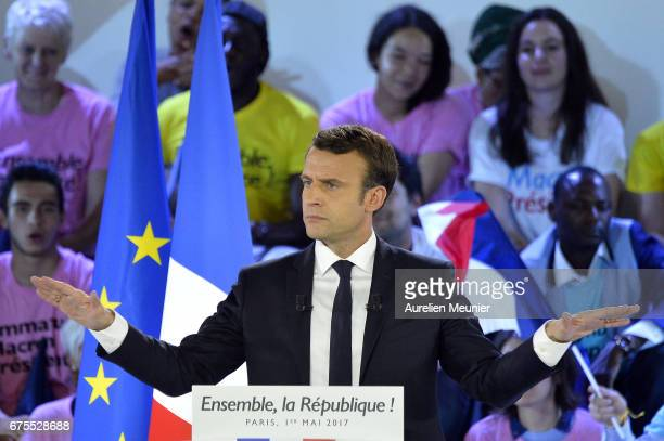 French Presidential Candidate Emmanuel Macron addresses voters during a political meeting at Grande Halle de La Villette on May 1 2017 in Paris...