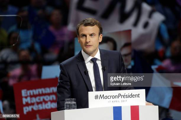 French presidential candidate Emmanuel Macron delivers a speech during a campaign rally at Bercy Arena on April 17 2017 in Paris France
