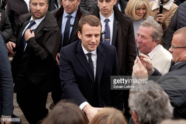 French presidential candidate Emmanuel Macron for the En Marche movement speaks with supporters as he leaves the Touquet polling station after voting...