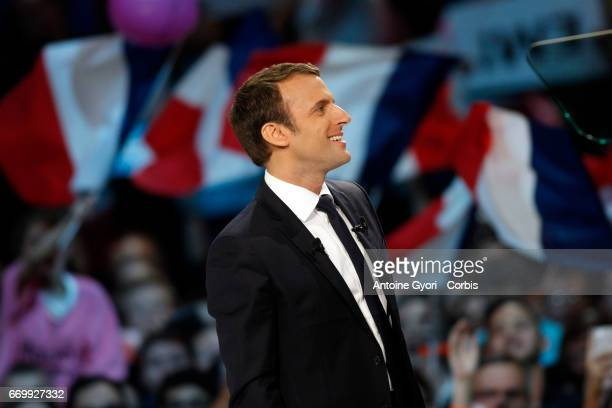 French presidential candidate Emmanuel Macron gestures as he delivers a speech during a campaign rally at Bercy Arena on April 17 2017 in Paris France