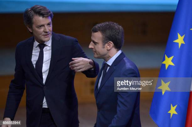 French Presidential Candidate Emmanuel Macron leaves after a conference at Maison de la Radio on March 22 2017 in Paris France The Presidential...
