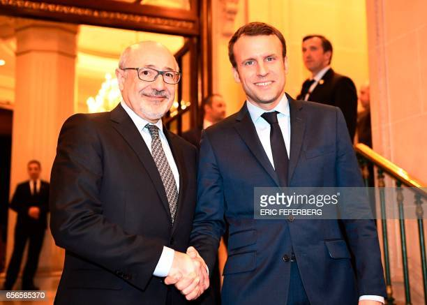 French presidential candidate for the 'En Marche' movement Emmanuel Macron shakes hands with president of the Jewish Institutions Representative...