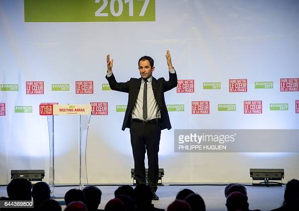TOPSHOT French presidential candidate for the leftwing French Socialist Party Benoit Hamon gestures during a campaign meeting on February 23 2017 in...