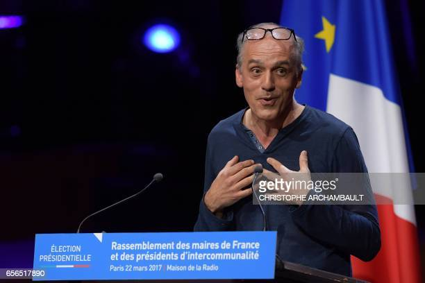 French presidential candidate for the New Anticapitalist Party Philippe Poutou speaks during a meeting with members of the Association of Mayors of...