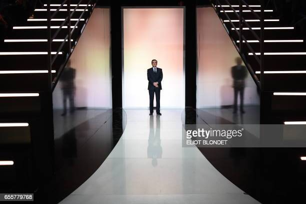 French presidential candidate for the rightwing Les Republicains party Francois Fillon stands before a debate organised by the French private TV...