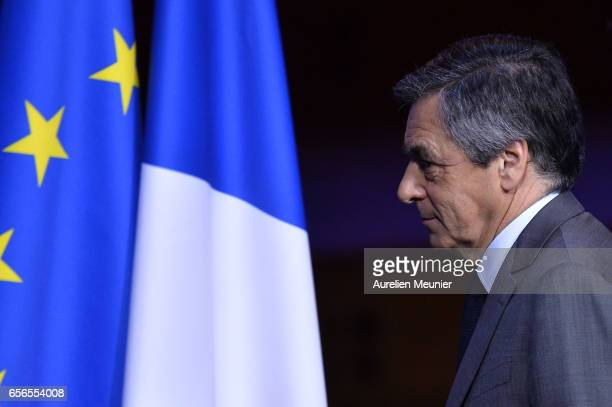 French Presidential Candidate Francois Fillon salutes the crowd after a conference at Maison de la Radio on March 22 2017 in Paris France The...