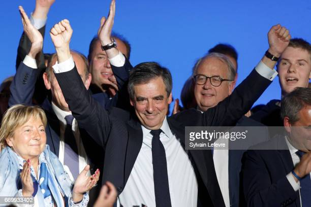 French presidential candidate Francois Fillon waves at the end of a rally party on April 18 2017 in Lille France France will go to the polls on April...