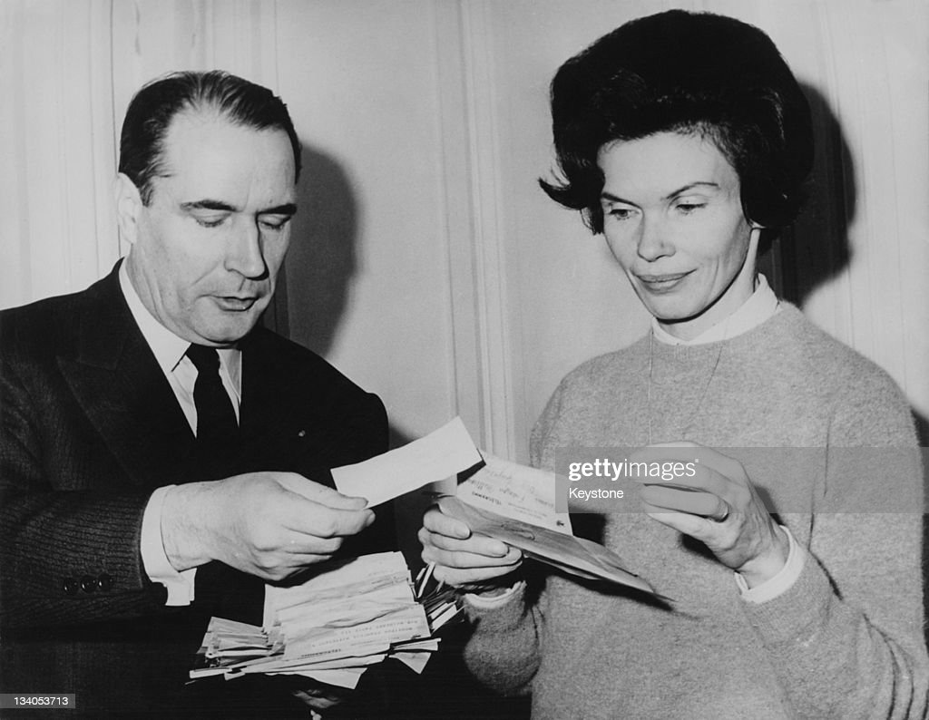 French presidential candidate <a gi-track='captionPersonalityLinkClicked' href=/galleries/search?phrase=Francois+Mitterrand&family=editorial&specificpeople=208938 ng-click='$event.stopPropagation()'>Francois Mitterrand</a> (1916 - 1996) and his wife Danielle (1924 - 2011) read congratulatory cables at their home, during the first round of the presidential election, 6th December 1965.