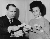 French presidential candidate Francois Mitterrand and his wife Danielle read congratulatory cables at their home during the first round of the...