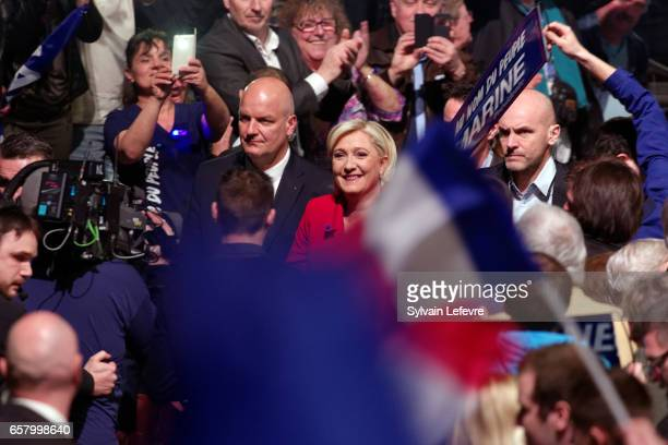 French presidential candidate Marine Le Pen arrives to speak during a rally meeting at Zenith on March 26 2017 in Lille France Le Pen tried to...
