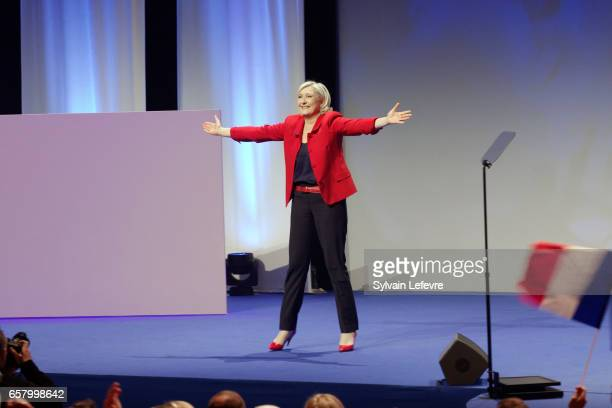 French presidential candidate Marine Le Pen waves as she arrives to speak during a rally meeting at Zenith on March 26 2017 in Lille France Le Pen...