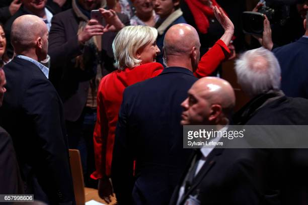 French presidential candidate Marine Le Pen waves to attendees as she arrives to speak during a rally meeting at Zenith on March 26 2017 in Lille...