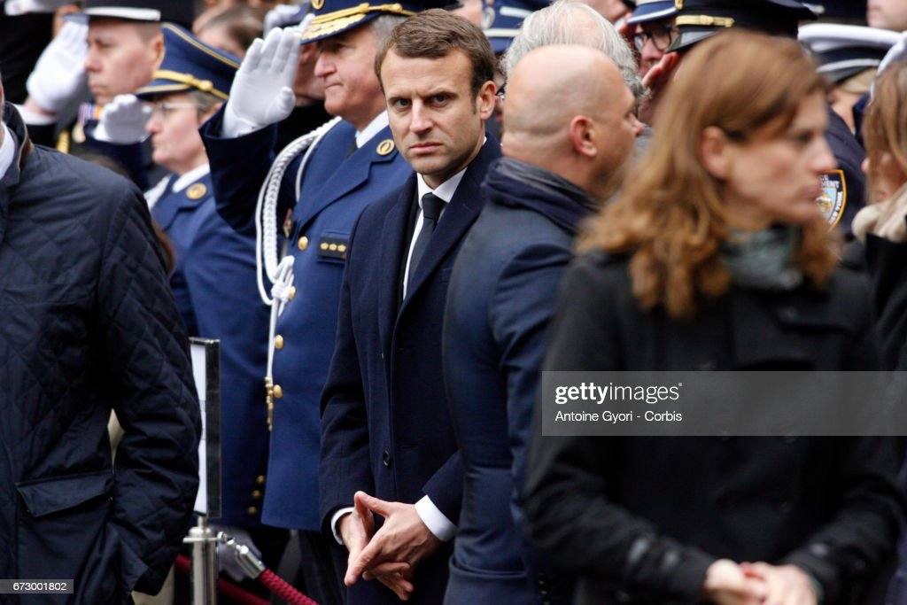 French Presidential Election candidate Emmanuel Macron attends the National tribute to fallen French Policeman Xavier Jugele on April 25, 2017 in Paris, France. French Police Officer Xavier Jugele, 37, was shot dead by a gunman on Thursday April 20, 2017 on Paris's Champs Elysees, a few days' prior to the French Presidential elections.
