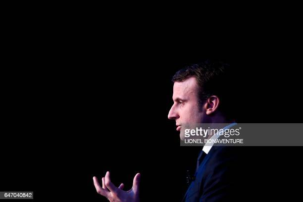 TOPSHOT French presidential election candidate for the En Marche movement Emmanuel Macron gives a speech as he unveils his full programme eight weeks...