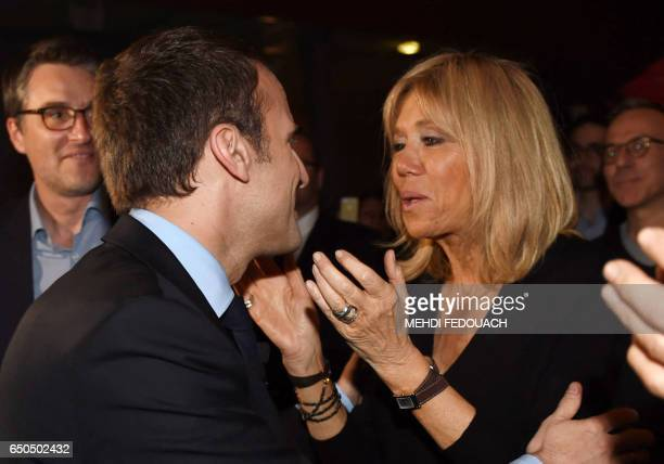 French presidential election candidate for the En Marche movement Emmanuel Macron kisses his wife Brigitte Trogneux as he arrives for a campaign...