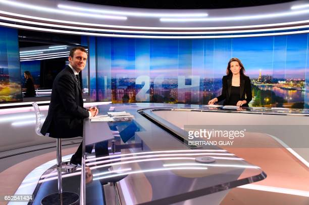 French presidential election candidate for the En Marche movement Emmanuel Macron and anchorwoman AnneClaire Coudray are pictured minutes prior to...