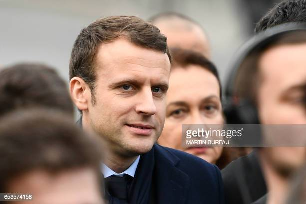 French presidential election candidate for the En Marche movement Emmanuel Macron and his spokesperson Laurence Haim attend a memorial to the victims...