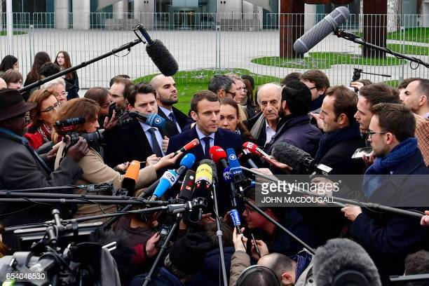 TOPSHOT French presidential election candidate for the En Marche movement Emmanuel Macron speaks to journalists after a meeting with German...