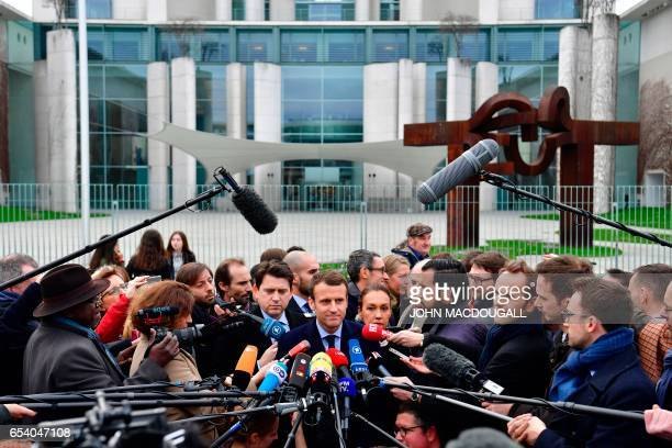French presidential election candidate for the En Marche movement Emmanuel Macron speaks to journalists after a meeting with German Chancellor Angela...