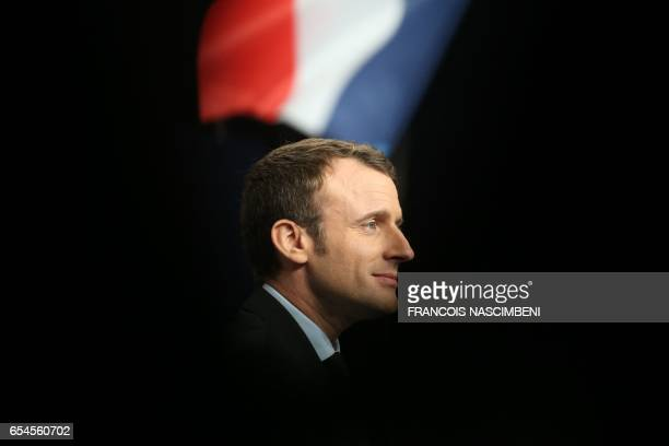 TOPSHOT French presidential election candidate for the En Marche movement Emmanuel Macron delivers a speech during a campaign rally in Reims on March...