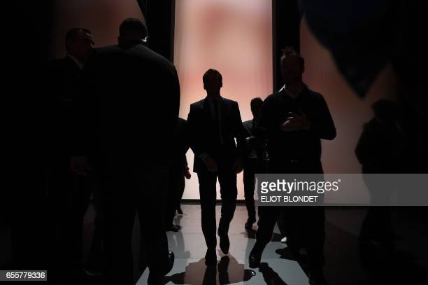French presidential election candidate for the En Marche movement leader Emmanuel Macron arrives to a debate organised by the French private TV...