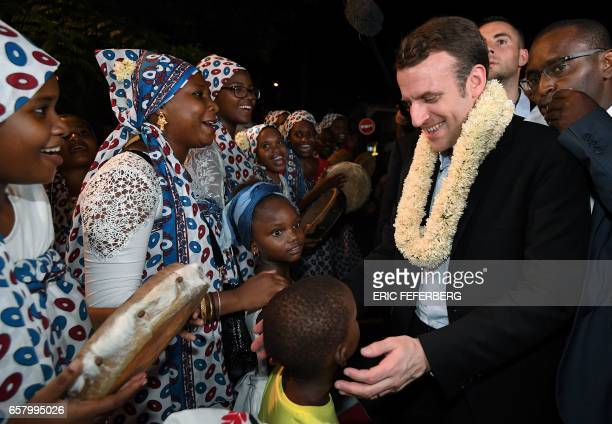 French presidential election candidate for the En Marche movement Emmanuel Macron is greeted upon his arrival in Dzaoudzi on French Indian Ocean...