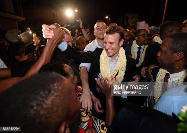 TOPSHOT French presidential election candidate for the En Marche movement Emmanuel Macron is greeted upon his arrival in Dzaoudzi on the French...
