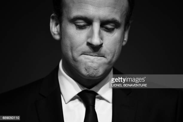 French presidential election candidate for the En Marche movement Emmanuel Macron gives a speech as he unveils his full programme eight weeks from...