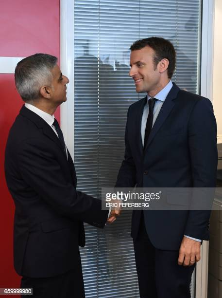 French presidential election candidate for the En Marche movement Emmanuel Macron and the mayor of London Sadiq Khan shake hands on March 29 2017 at...