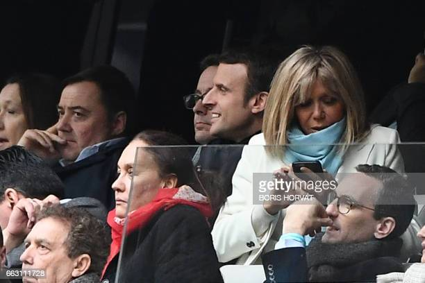 French presidential election candidate for the En Marche movement Emmanuel Macron his wife Brigitte Trogneux and his spokesperson Laurence Haim...