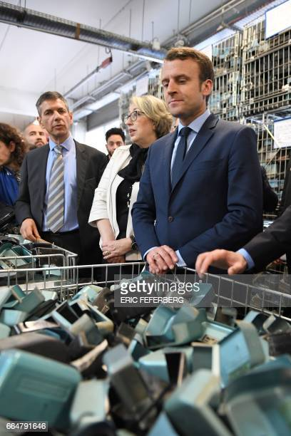 French presidential election candidate for the En Marche movement Emmanuel Macron stands next to former Social Cohesion Junior Minister MarieAnne...