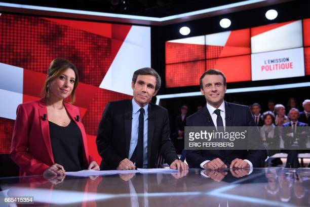 French presidential election candidate for the En Marche movement Emmanuel Macron poses with journalists and television hosts David Pujadas and Lea...