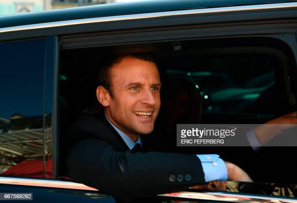 French presidential election candidate for the En Marche movement Emmanuel Macron smiles in a car during a campaign visit in Bagneres de Bigorre on...