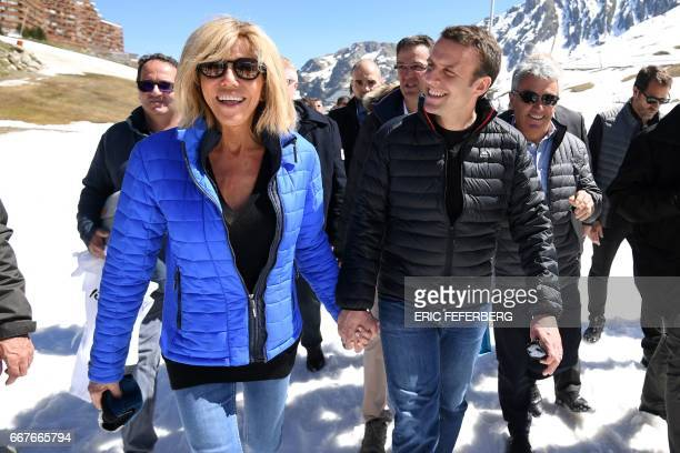 French presidential election candidate for the En Marche movement Emmanuel Macron and his wife Brigitte Trogneux arrive for a lunch break at the...