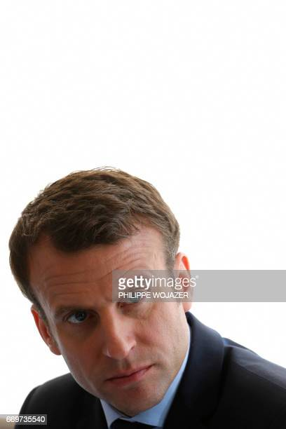 French presidential election candidate for the En Marche movement Emmanuel Macron visits the International Food Market in Rungis south of Paris on...