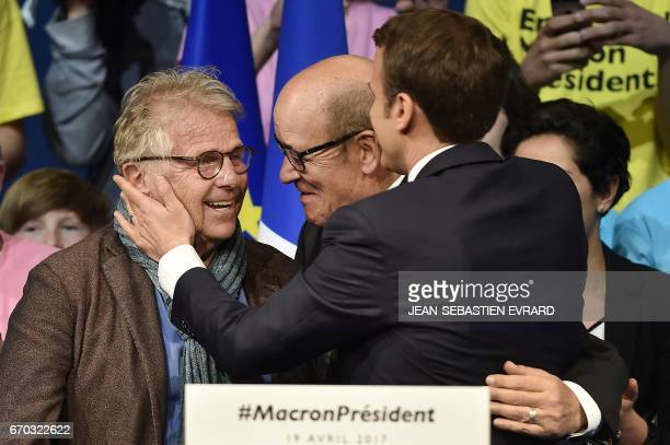 French presidential election candidate for the En Marche movement Emmanuel Macron is congratulated and laughs with Defence Minister JeanYves Le Drian...